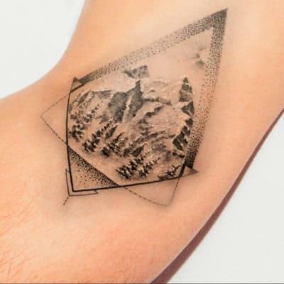 tatuaje estilo bosque